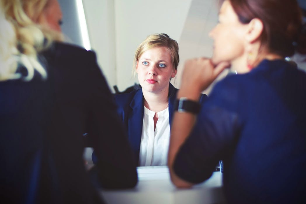 woman listening to her lawyers